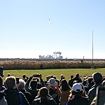 A crowd watches from a safe distance as Northrop Grumman launches its 12th cargo resupply mission to the International Space Station from Pad-0A of NASA's Wallops Flight Facility in Virginia Nov. 2, 2019. Credits: NASA/Bill Ingalls